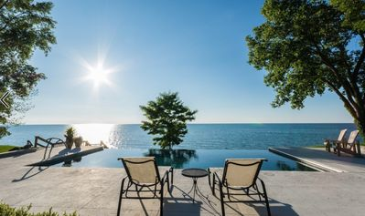 Enjoy your private swimming pool with views of the lake