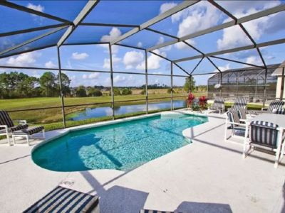 Photo for 7 Bedroom, 4.5 Bath & Enclosed Pool. Lake View and Three Miles to Disney!