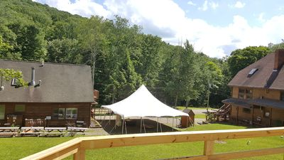 View from Pavilion Barn deck, Setting Up a Tent for an On-Site Private Wedding.