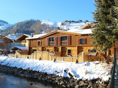 Photo for Spacious Chalet with Jacuzzi in Kaprun