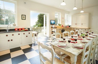 Ground floor: Kitchen with dining. The dining table has an extension and will seat 16 guests