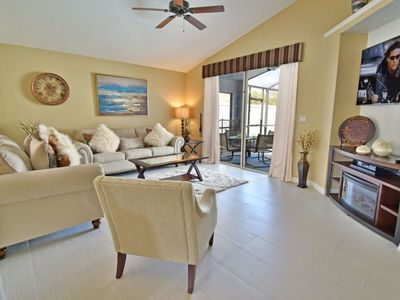 Photo for Fully screened in pool is surrounded with a fence to offers complete privacy
