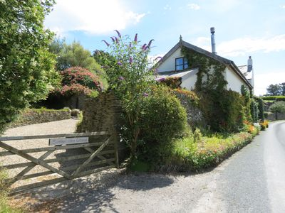 Photo for 3 bedroom character cottage, wood burner, large garden, play area, sea views