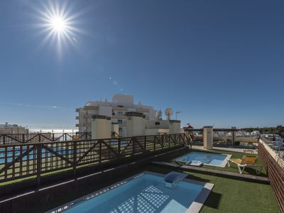 Photo for Ocean`s Terrace Apartment - 200mt from the Beach - Terrace with Swimming Pools