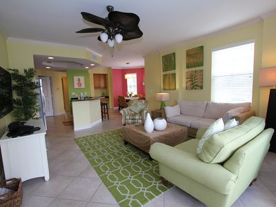 Photo for Beautiful corner end unit overlooking pool and lake with fountain.  Minutes to the beach!
