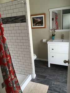 Master bath with shower and door to access the backyard