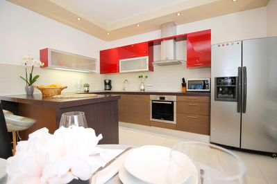 fully equipped kitchen with living room - air conditioned