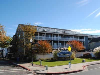 Photo for Cozy 2 bedroom ocean block condo with free WiFi and view of bay and exciting downtown just two blocks from the beach!