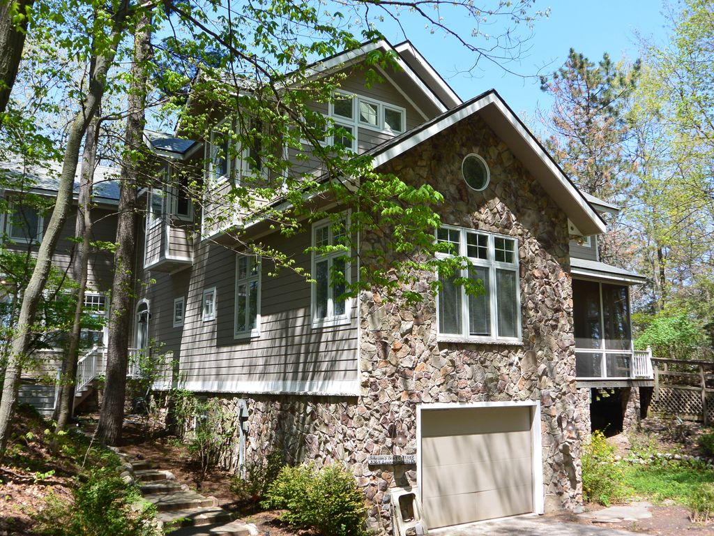 Private Lake MI Beach With Custom Home HomeAway Bridgman - And architectural cottages on secluded private pond homeaway