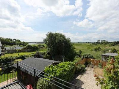 Photo for BOURNECOAST: House nestled on the waters edge of the Stanpit Marshes - HB5901