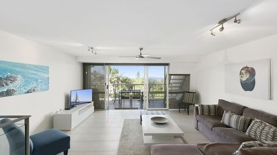 Spacious living level opening to balcony leading to rooftop terrace - enjoy view