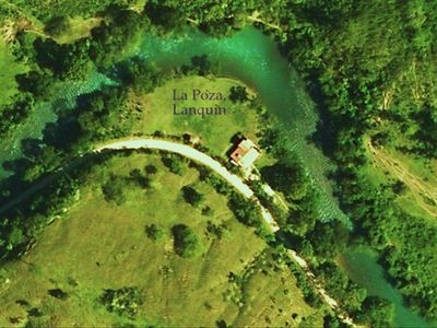 Birds eye view of La Poza Riverside Guesthouse, the River Lanquin.