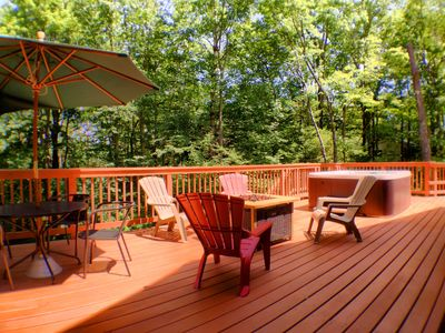Great, big back deck with dining area, lounge chairs, fire pit, BBQ and hot tub.