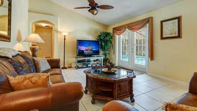 "The family room with a 65"" HDTV, enhanced cable package, PS4 and DVR."