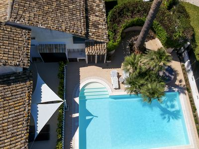 Photo for Orange house with lawn and use of swimming pool and jacuzzi just 300 meters from the sea