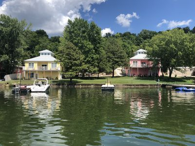 Pink home is lakefront in Redhead Cove.