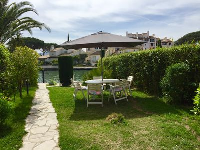 Photo for Beautiful south facing apartment in Port Grimaud renovated with large garden and mooring