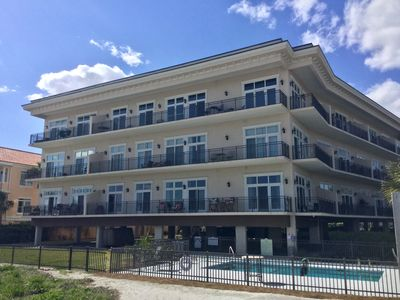 Photo for Beautiful ocean view condominium with pool just steps to our beautiful beaches.