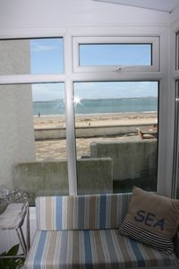 Sun Room and beach beyond.this is the entrance to your ptoperty.via the beach.