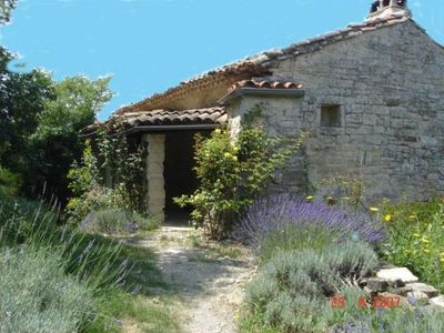 Photo for Romantic stone house in a olive- palmtrees garden, terrace & Cevennes Panorama
