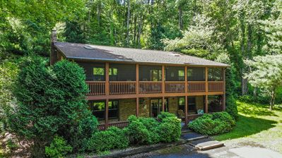 Photo for Centrally located getaway with hot tub & screened porch!