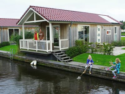 Photo for Luxury, waterfront chalet with access to Frisian lakes