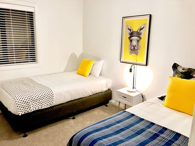 Second bedroom with king single and single beds