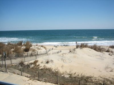 Photo for Spacious, comfortable 2 bedroom oceanfront condo with WiFi and a fabulous view of the ocean located midtown and just steps to the beach!