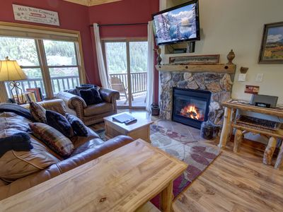Photo for Come enjoy this fantastic 2 bedroom condo walking distance to the Mountain House lifts! You will love the views of the wetlands and Keystone slopes from the living room and balcony. The vaulted ceilings and windows give the living room an airy feel and ple