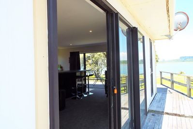 Entrance slider with deck leading to private estuary deck