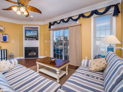 Spacious four level townhouse with four balconies you can enjoy views of both the ocean and the bay!