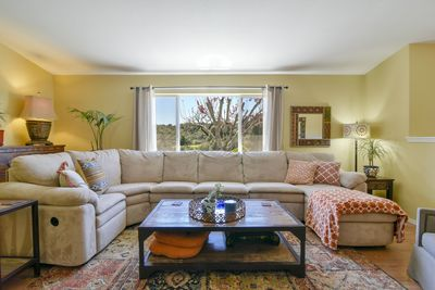 The living room is nicely furnished for your group