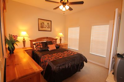 downstairs master bedroom with a queen