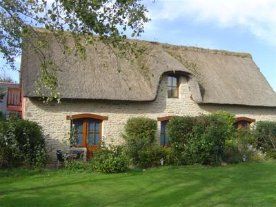 Photo for Studio in a beautiful thatched cottage, near Pointe de la Torche