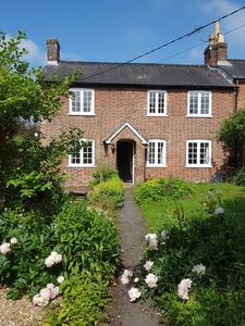 Photo for Charming Grade II listed cottage in a beautiful quintessential English village