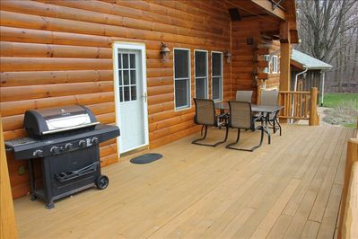 Close up of back deck, gas grill, seating for 8. Beautiful!