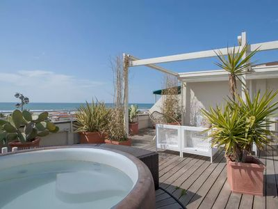 Photo for Luxury penthouse with jacuzzi, terrace in front of the beach