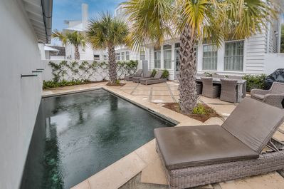 Rosemary Beach - Pool area with lounge seating and dining space.