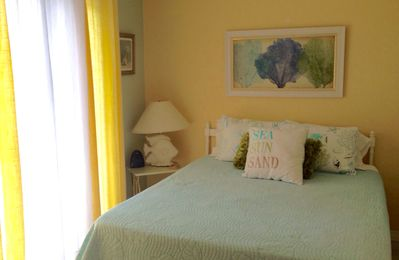 Photo for Coastal Chic beauty awaits you!  Steps to the beach, super clean!