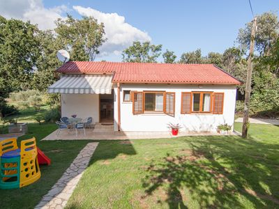Photo for Cozy cottage for sole use with 2 bedrooms, kitchen, bathroom, air conditioning, garden, barbecue, children's playground and only 200 meters to the beach