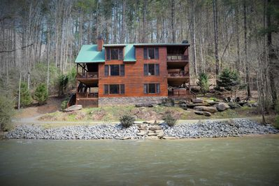 Large Waterfront lodge just steps from the river. Big Porches on every level.