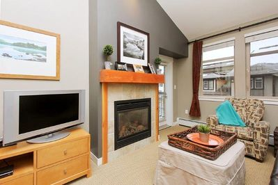 Cozy living area with flat screen TV and gas fireplace