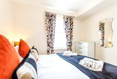 Bright comfortable bedroom with king size bed