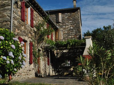 Photo for Former coaching inn 14 pers - river bank - Cevennes