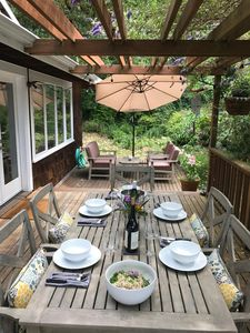 Al fresco dining on the deck! There is also a lovely view of the water.