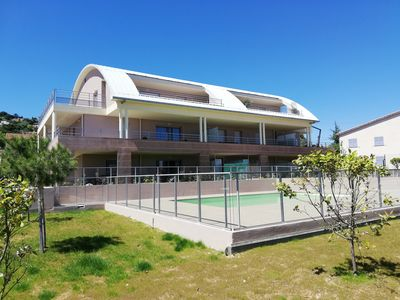Photo for Near the beach, with pool, F2 New, modern, air conditioned, with closed garage