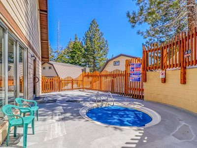 Photo for Condo w/ forest & mountain view & shared hot tub/game room - walk to Village!