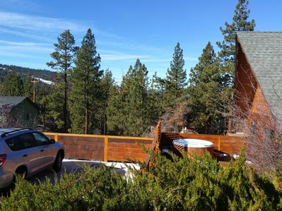 Private with elevated deck, plenty of parking and views of Summit and Bear Mntn.