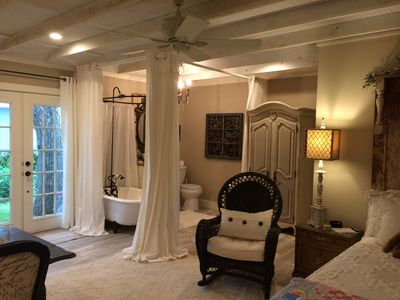 Photo for Beautiful Brenham garden cottage full of charm, antiques & lush landscaping