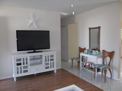 Watch a movie and relax in the spacious main living room.